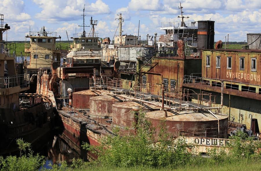 Abandoned ships of the Russian federal fleet are seen at the repair-operational base of the river fleet of the Yenisei river shipping company in Podtyosovo village