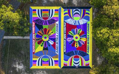 L'arte di Lakwena colora due campi da basket in Arkansas